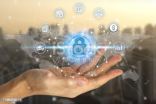 906892336 istock photo Businessman hand holding network using padlock over the Network connection technology 1166309114