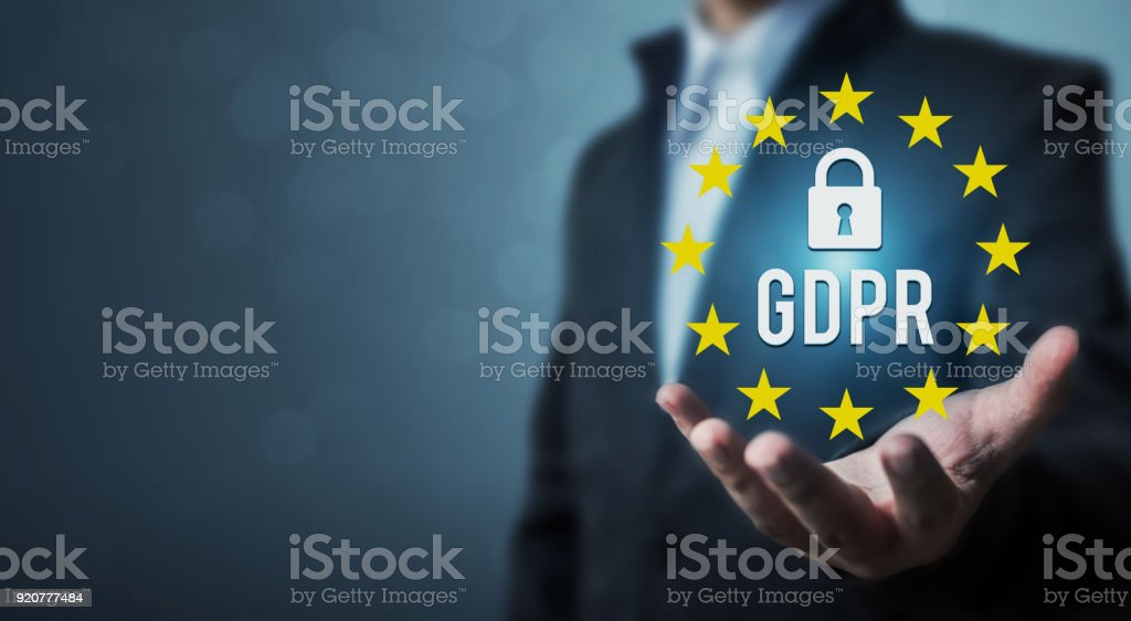 Businessman hand holding sign general data protection regulation (GDPR) and key icon stock photo