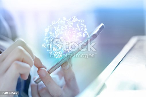 istock businessman hand holding smart phone connecting to internet and social media icons 848025468