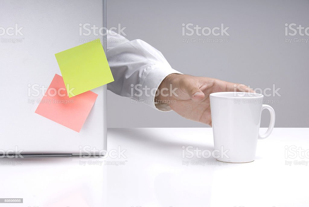 Businessman hand is reaching to hold a mug royalty-free stock photo