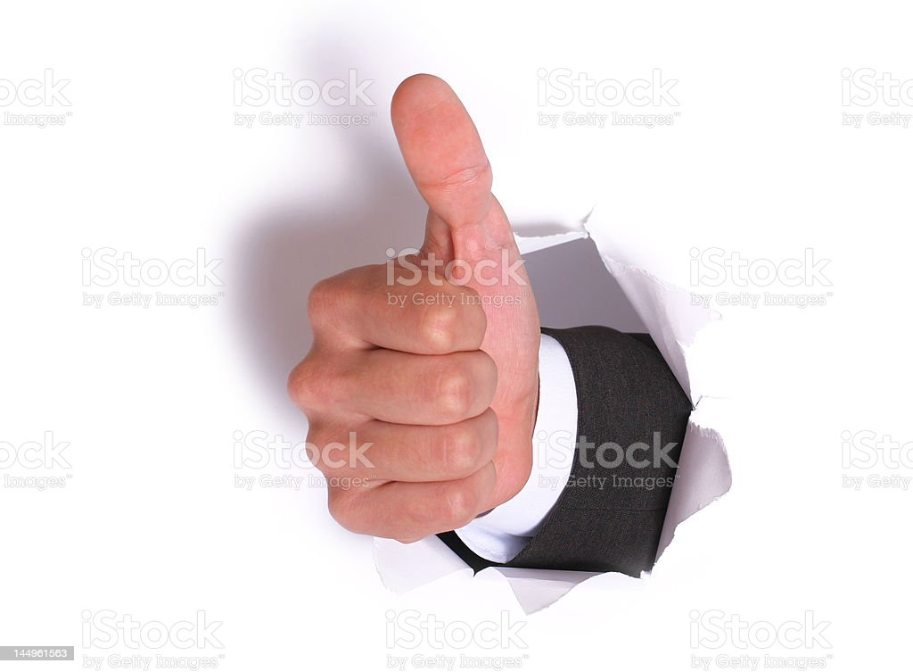 businessman hand OK in the white paper hole. with shadow royalty-free stock photo