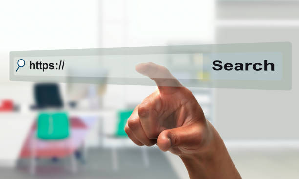 businessman hand pointing at search bar on virtual screen at office stock photo