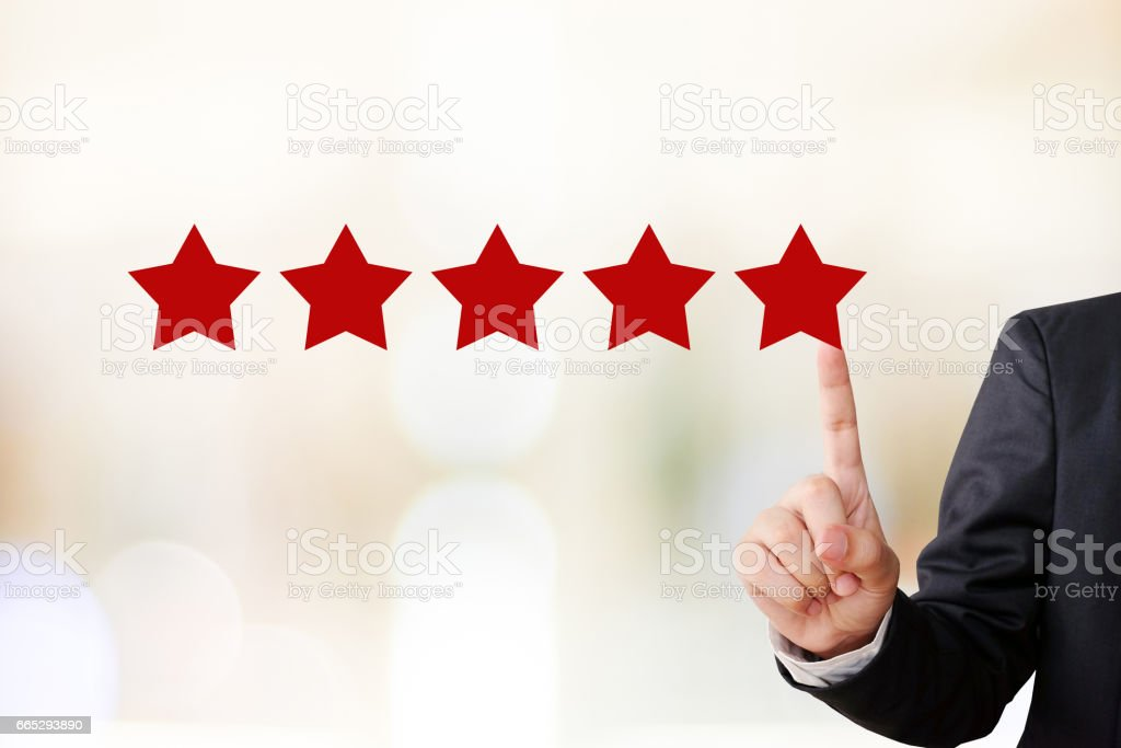 Businessman hand pointing five star, customer satisfaction concept, business background stock photo