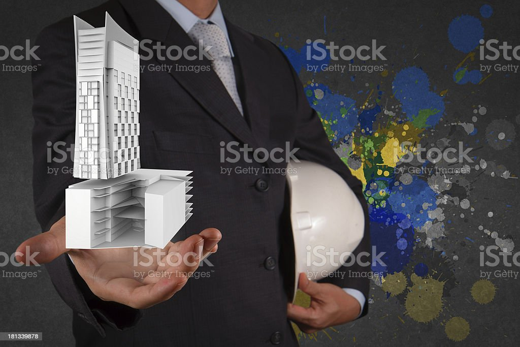 businessman hand presents building development royalty-free stock photo