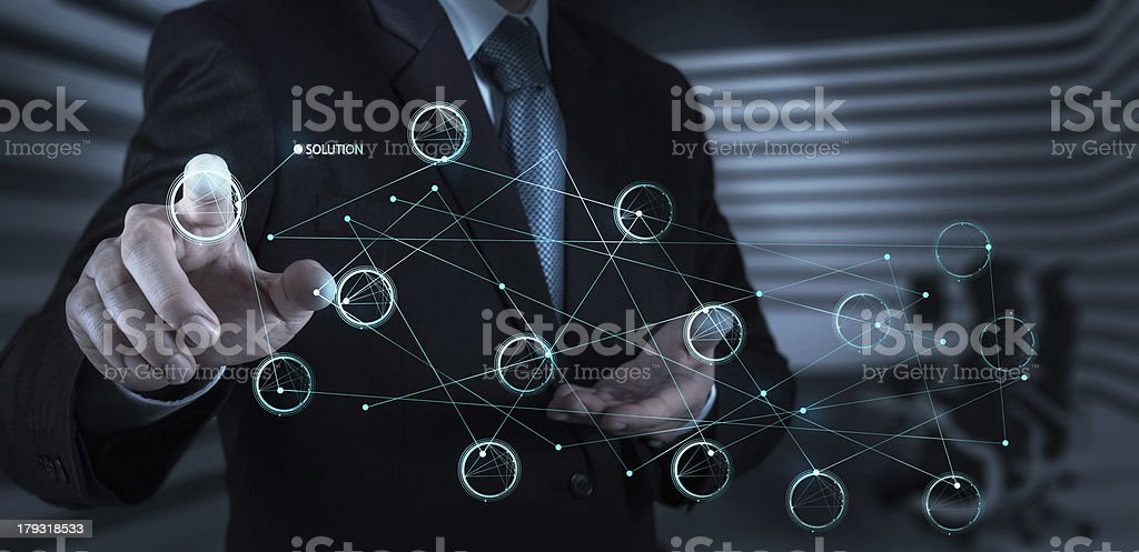 businessman hand pushing solution diagram on a touch screen inte stock photo