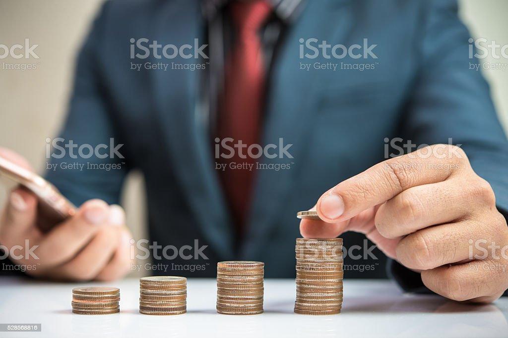 Businessman Hand Put Coin stock photo