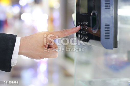 1058987638 istock photo Businessman hand scanning finger on machine,Technology concept, Business concept, 1031859594