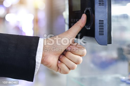 1058987638 istock photo Businessman hand scanning finger on machine,Technology concept, Business concept, 1031862462