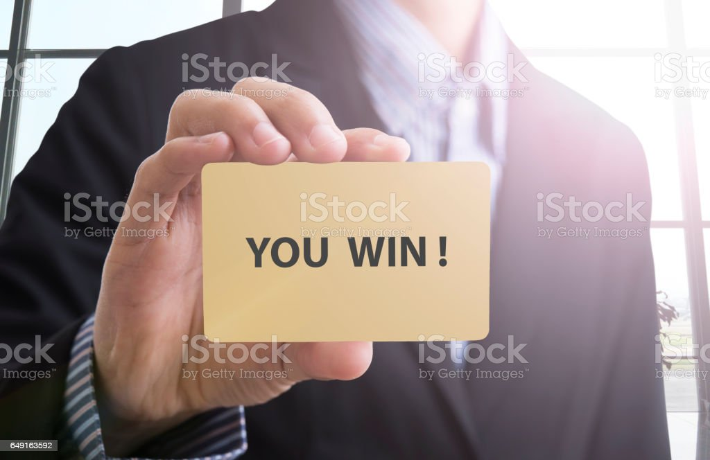 Businessman hand show banner you win text. stock photo