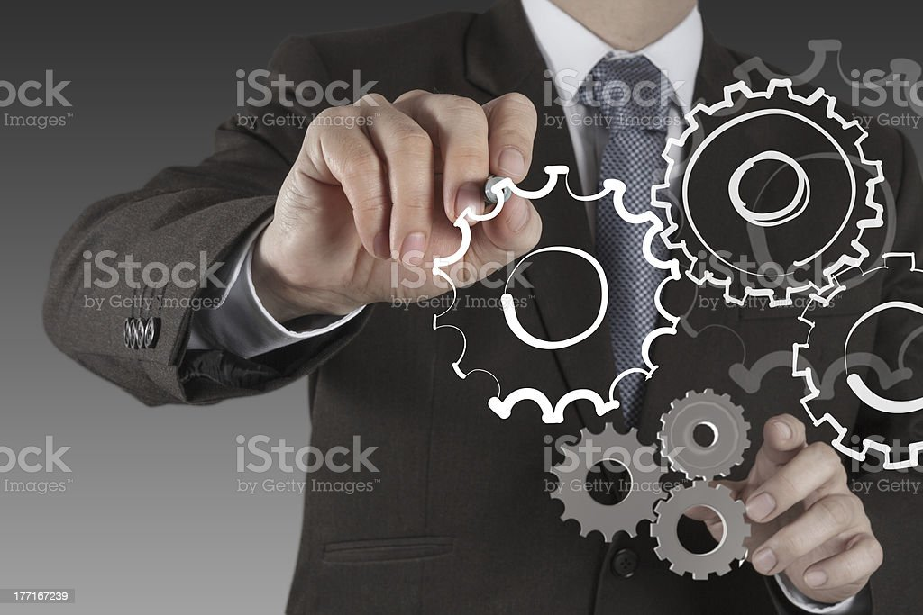 businessman hand show gear to success royalty-free stock photo
