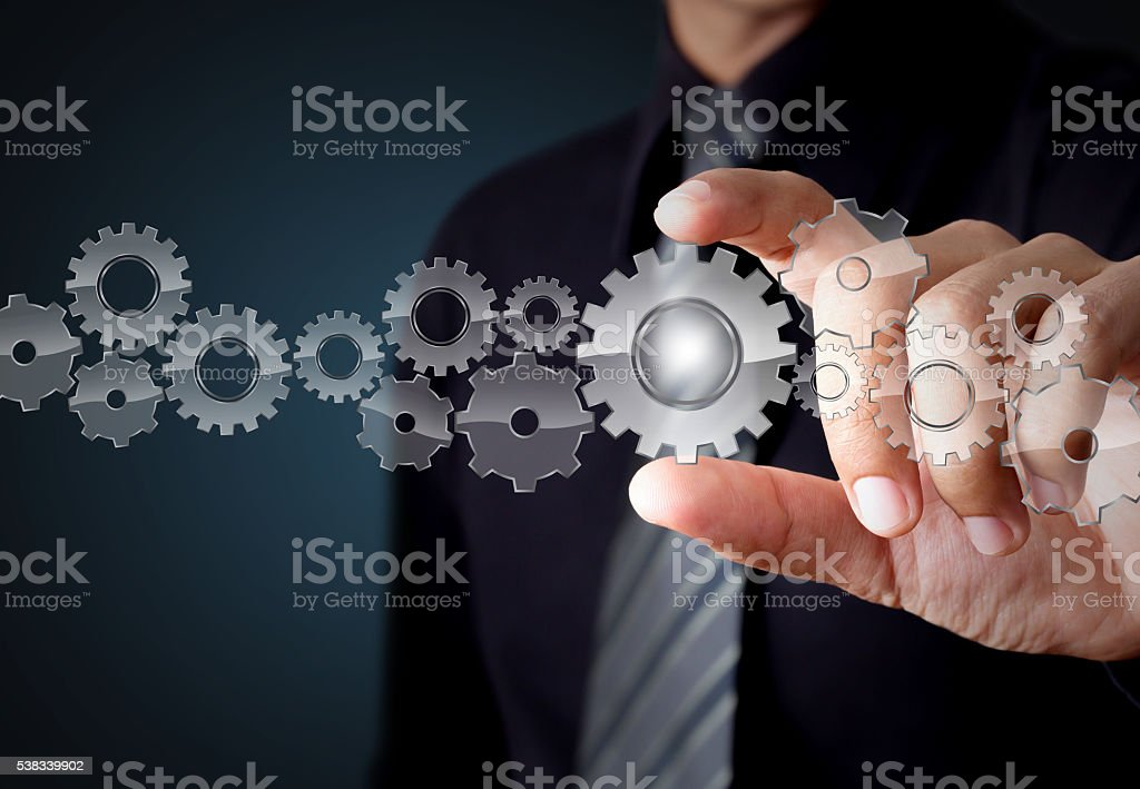 Businessman hand show glass gear to success as concept stock photo
