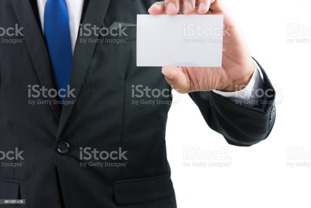 Businessman hand showing business card or note paper royalty-free stock photo