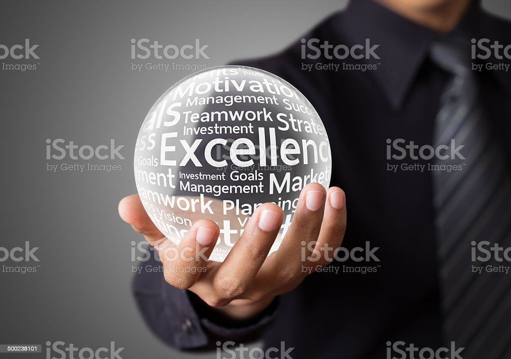 Businessman hand showing excellence word stock photo