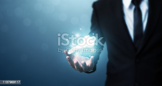 istock Businessman hand showing key to success. Problem solving to overcome work obstacles 1137969117