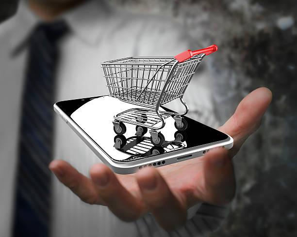 Geschäftsmann hand mit Warenkorb mit smart phone – Foto
