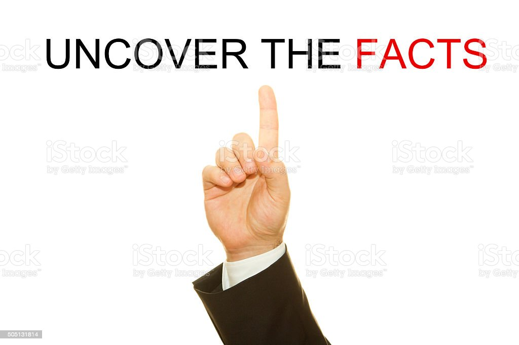 Businessman hand showing the word uncover the facts stock photo
