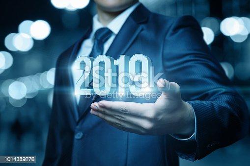istock Businessman hand shows 2019. 1014389276