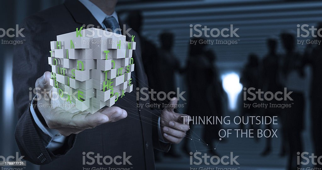 businessman hand shows word thinking outside the box royalty-free stock photo