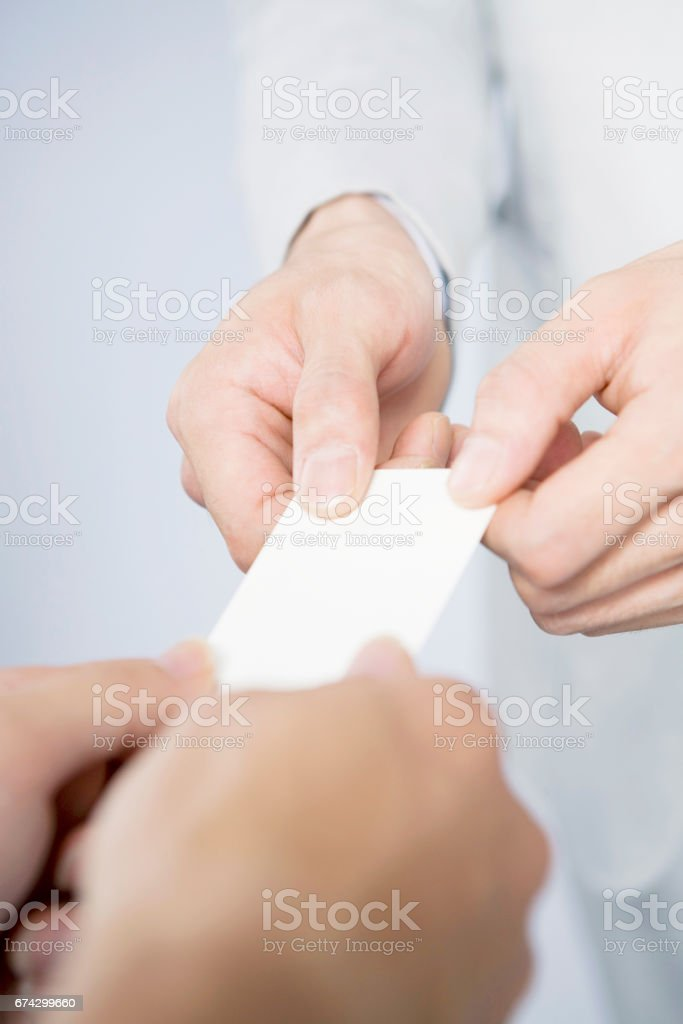 Businessman Hand To Exchange Business Cards Original stock photo ...