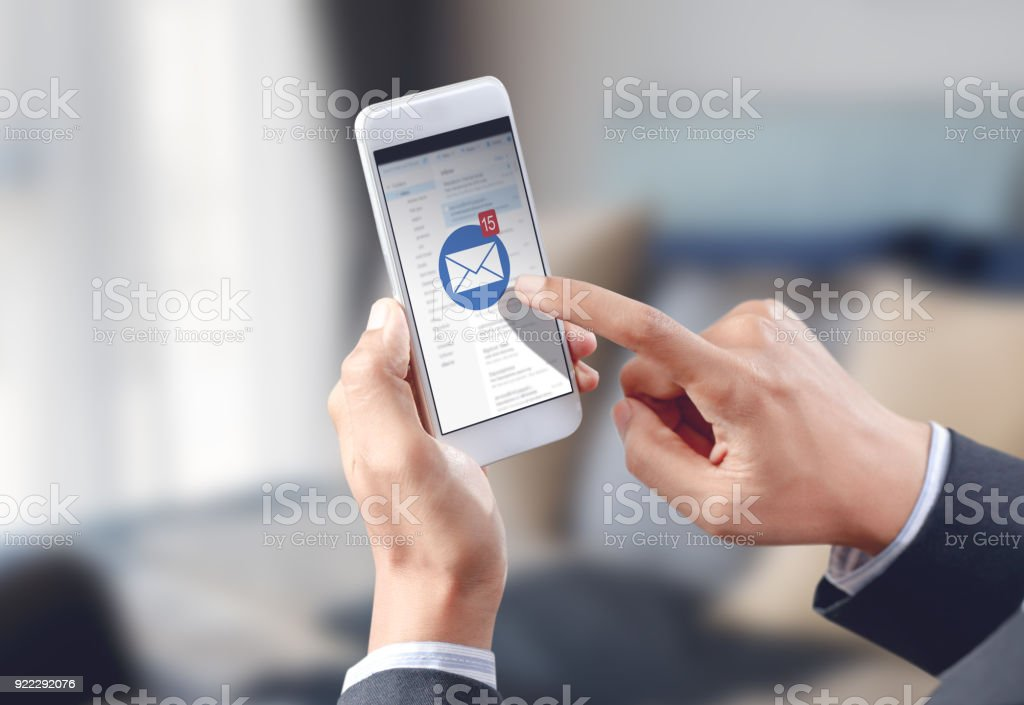 businessman hand touch email envelope icon on mobile screen - fotografia de stock