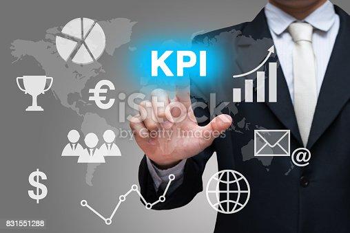 Businessman hand touch KPI symbols on gray background