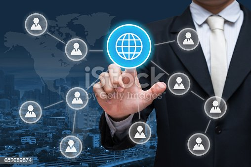 istock Businessman hand touch social media symbol on city background 652689874