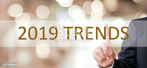 istock Businessman hand touching 2019 trend over blur office background, banner, 2019 business strategy annual plan, success in business concept 1057830844