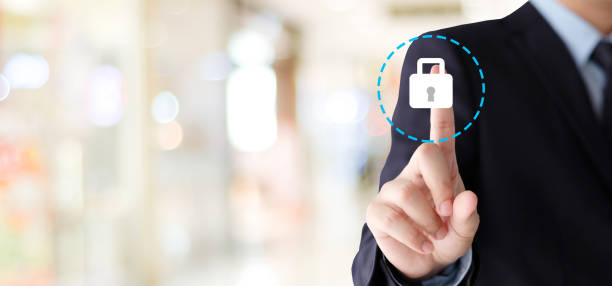 Businessman hand touching  cyber security icon over blur background with copy space,business and technology background, banner stock photo