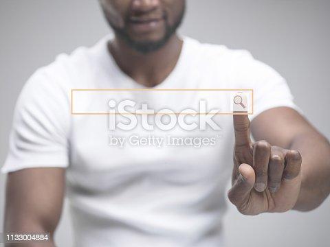 istock Businessman hand touching empty virtual screen 1133004884