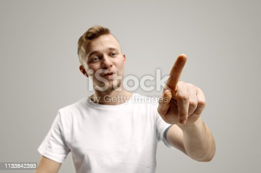 istock Businessman hand touching empty virtual screen 1133842393