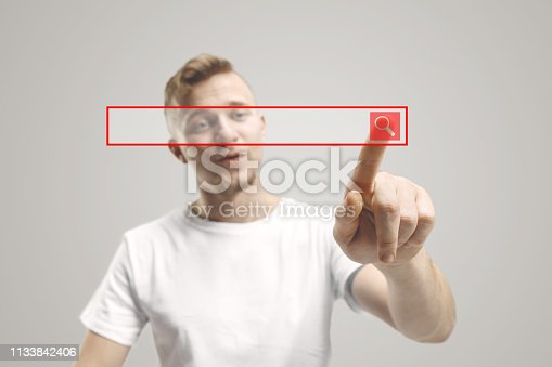 istock Businessman hand touching empty virtual screen 1133842406