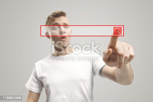 istock Businessman hand touching empty virtual screen 1133842408