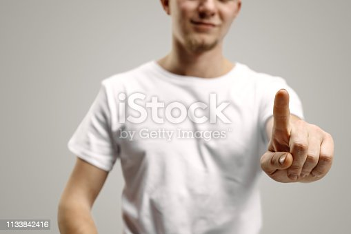 istock Businessman hand touching empty virtual screen 1133842416
