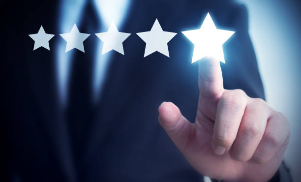 Businessman hand touching five star symbol to increase rating of company concept, Copy space background for your title stock photo