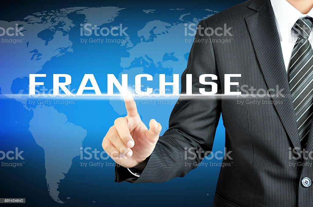 businessman hand touching franchise sign on virtual screeen stock