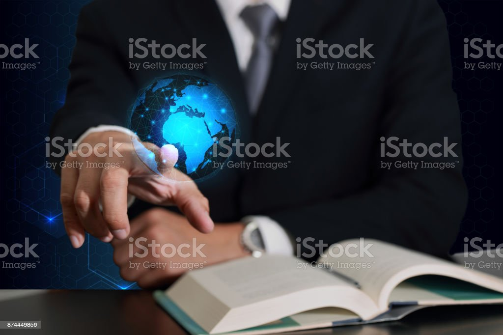Businessman hand touching future sign and light blue circular world map line networking on hexzgonal background as business, globalization, communication and innovation concept stock photo