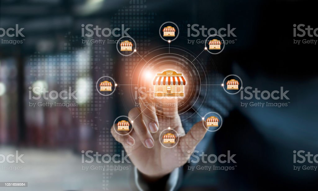 Businessman hand touching icon global network connection on franchise marketing system. Branch of market and customer. Modern technology business. stock photo