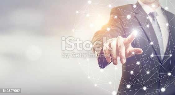 istock Businessman hand touching map point, network connection 642827962