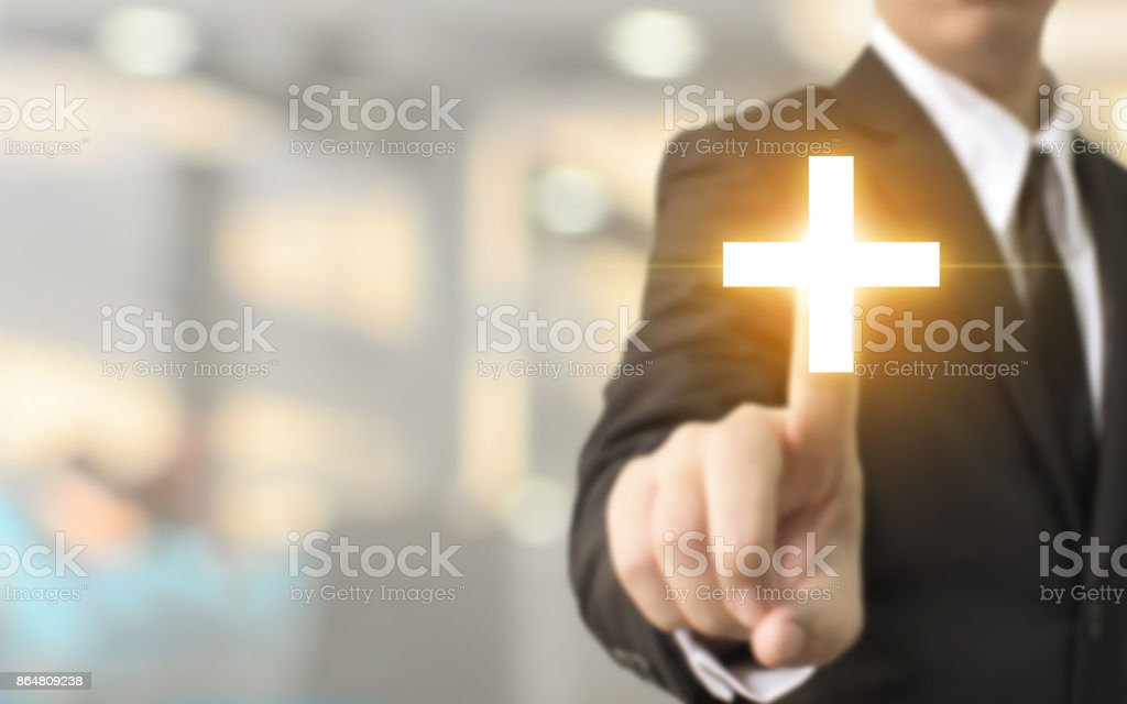 Businessman hand touching plus sign with blurred background, Business offer positive, benefit and development concept stock photo