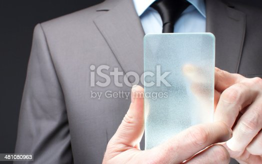 171347585 istock photo Businessman hand touching to futuristic smart phone glass empty 481080963