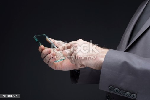 171347585 istock photo Businessman hand touching to futuristic smart phone glass empty 481080971