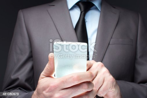 171347585 istock photo Businessman hand touching to futuristic smart phone glass empty 481080973