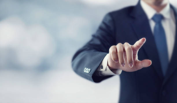 Businessman hand touching virtual screen stock photo