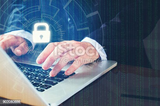 istock Businessman hand using laptop with Cyber security job business and network server concept 902080886