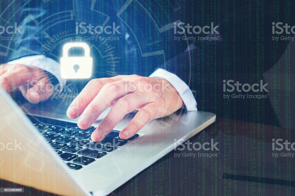 Businessman hand using laptop with Cyber security job business and network server concept stock photo