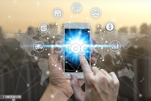 istock Businessman hand using smart phone the Network connection technology 1166309109