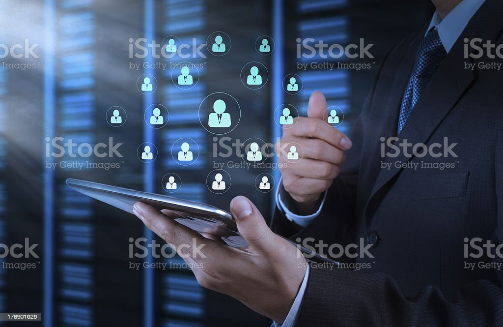 businessman hand using tablet computer and server room royalty-free stock photo