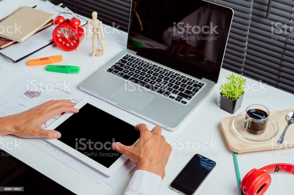 Businessman hand using tablet,laptop, online banking payment - Royalty-free Banking Stock Photo