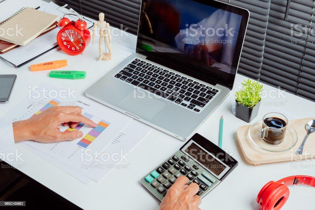 Businessman hand working with financial data and calculator zbiór zdjęć royalty-free