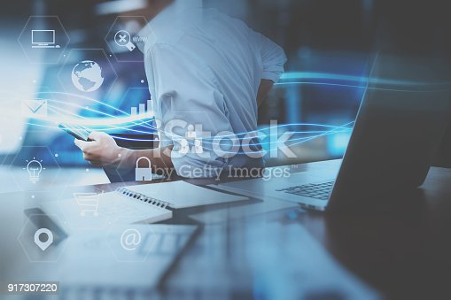 917307226istockphoto businessman hand working with mobile smart phone in modern office with virtual icon diagram 917307220